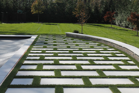 Grass and Marble Patio by Curti's Landscaping