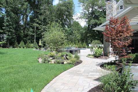 Stone Walkway and Landscaping Design and Installation by Curti's Landscaping