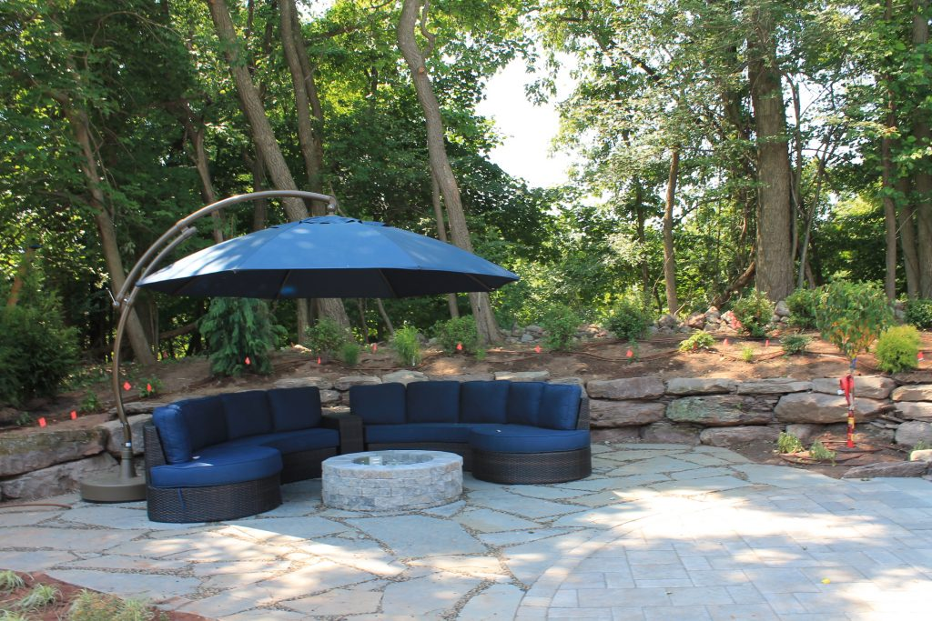 stone patio with fire pit and landscaping