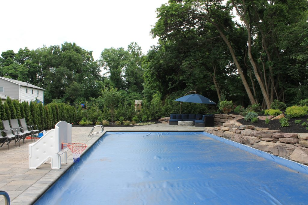 pool coping, patio, stone wall